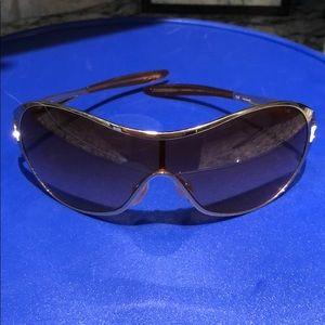 Gold Oakley sunglasses